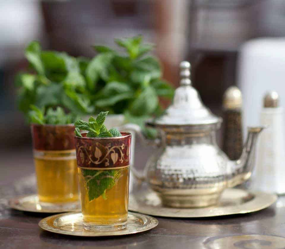 Moroccan mint tea and fresh mint leaves