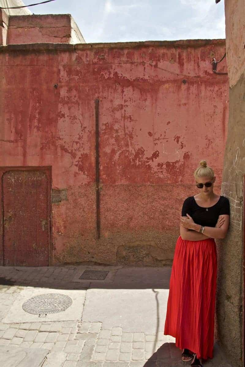 woman in Moroccan Medina wearing a skirt