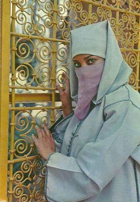 Beautiful Moroccan woman wearing a djellaba